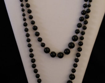 Double strand Small-to-Large black glass pearls and metal beads. Magnetic slider clasp.