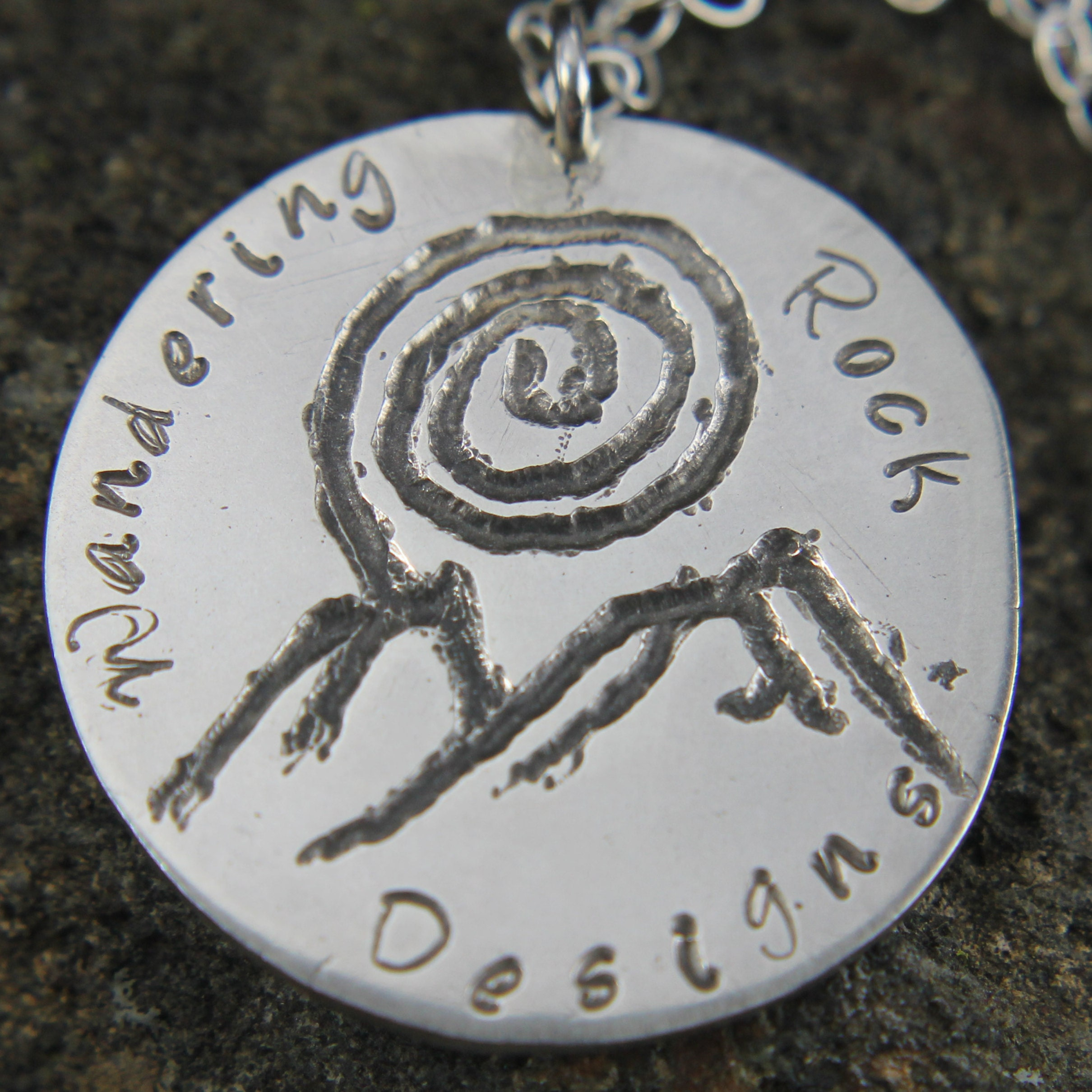 WanderingRockDesigns - Capturing life's moments in metal and stone.
