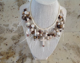 Dramatic cross necklace in brown and cream tones