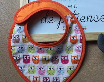 CUSTOMIZABLE bib, orange with cool patterns.