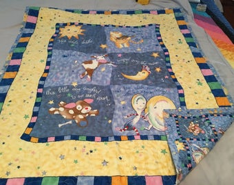 Machine quilted nursery rhyme quilt.  Boy or girl.  35x42