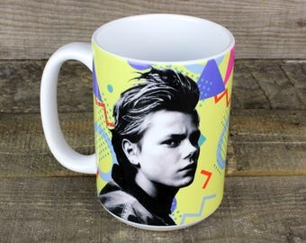 River Phoenix rip MUG keeps your coffee HOT well keeps your coffee contained is more accurate but its  80s nostalgia and you want it