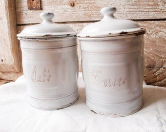 Set of two French brocante white enamel canisters