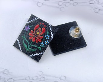 Hand-painted earrings on leather