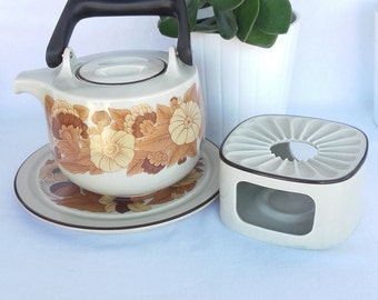 Rosenthal teapot, heater and stand plate