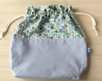 Very nice wrap in cotton or knitting or crochet work bag