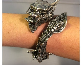 Dragon Cuff. Sterling Silver with onyx eyes. Amazing statement!