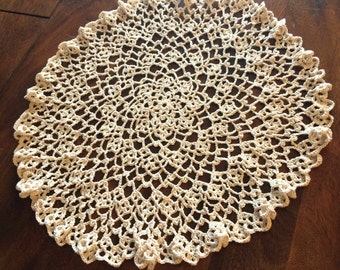 Crocheted doily with delicate, ruffled edges.