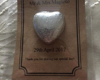 Personalised milk chocolate heart wedding favours on brown card