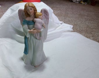 Beautiful vintage angel holding baby figure. Homco. Home interior.