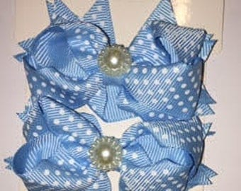 Light Blue with White Polka Dots shoe bows that come with a magnetic snap to attach to SASSAFLATS shoes they can also be worn in the hair