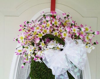 Moss purse basket with white flowers