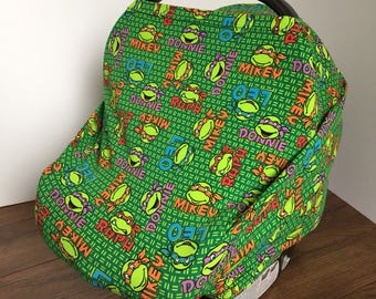 Banded Bottom Car Seat Cocoon. Tailored Bottom. Multi-Use. Teenage Mutant Ninja Turtles. Green, Milti-colored