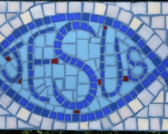 Christian fish symbol mosaic in blues on white background