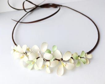 Headband with delicate blossoms in ivory pastel