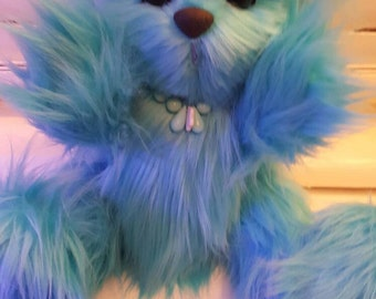 Izzy. A collectable and cute turquoise bear