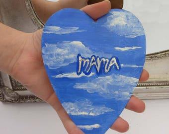 Mama heart with cloudy sky