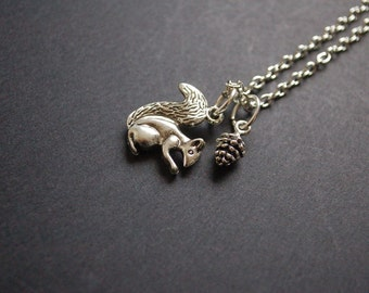 silver tone squirrel pine cone necklace