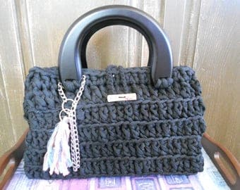 Crocheted handmade color black handbag made of matter recyclestyle t-shirt
