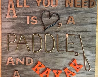 All You Need is Love, a Paddle and a Kayak sign on distressed wood with painted hardware and letters. Great lake house decor!