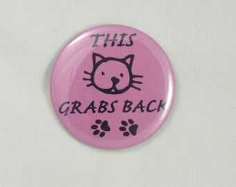 """This Pussy Grabs Back Button. 2.25"""" pin-back button. Protest Buttons. Resist Buttons. Anti-Trump Buttons. Resistance Buttons"""