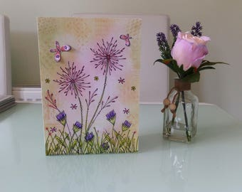 Flower card embellished with 3d butterfly.