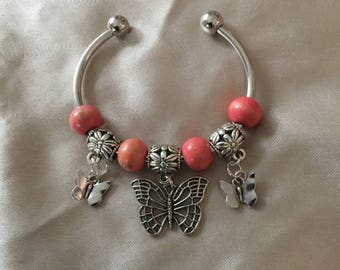 Butterfly and pink bead bangle bracelet