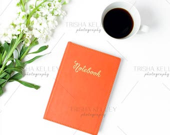 Orange Notebook with Coffee