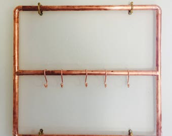 Copper Pipe Rack Is ready to give your house a very stylish finish