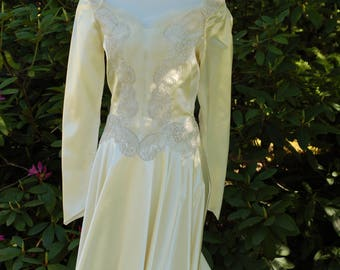 1950's vintage ivory satin wedding dress with long train made by William Cahill size 2-4