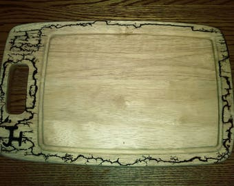 Wood cutting board with fractoral image of a fish