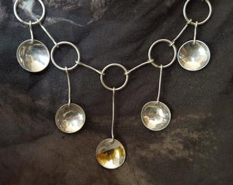 Handmade silver chain with 5 hanging concave discs. A modern take on a Georgian design.