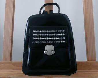 Brand new spiked vinyl black backpack