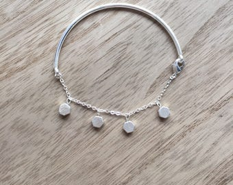 Semi-rigid silver bracelet, chain and charms