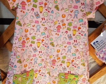 Girls pink summer dress with pockets and short sleeves.