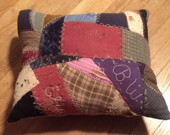 Pillow made out of a hundred year old quilt