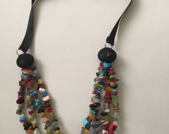 Handmade necklace with lots of different colours of beads