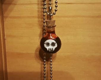 Glass bottle pendant with fake blood and skull