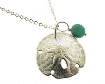 Sand Dollar Necklace, cast in sterling silver with a turquoise bead, beach jewelry by Kathryn Riechert
