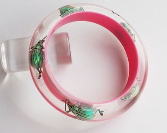 Bright pink lucite bracelet with real insects