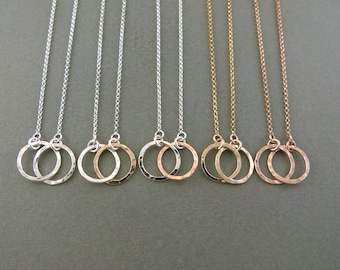 Embrace Pendants in Sterling Silver and 14K Gold and Rose Gold Fill