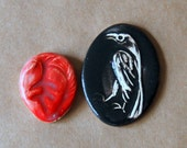 2 mosaic tiles - a red leaf-heart and a raven