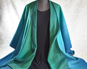 Hand woven, cotton ruana shawl, in a green and blue color blend,