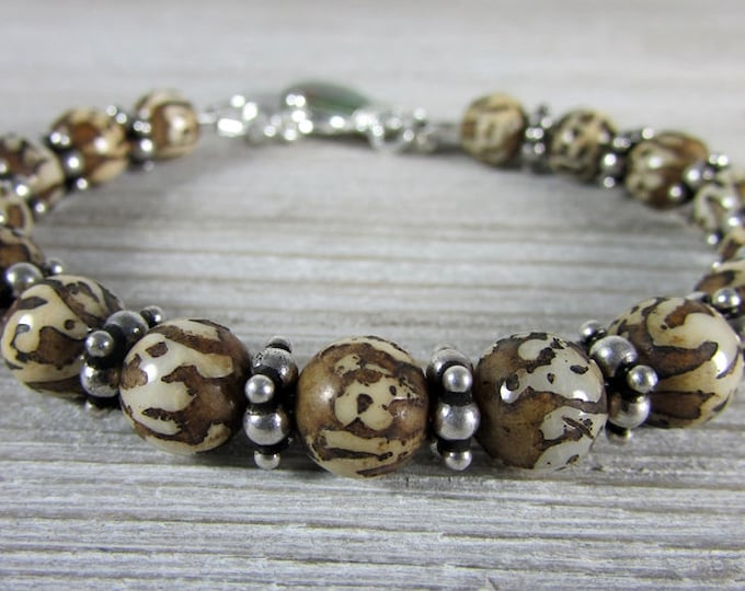 Carved Nepal Shell beads & Sterling Silver Bracelet