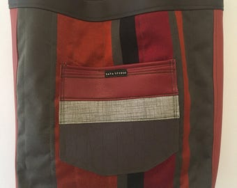 Vertical striped upholstery fabric and vinyl tote.