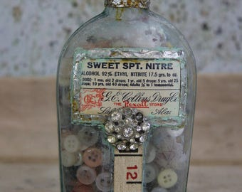 Vintage ALTERED BOTTLE Seafoam Green Bottle with Medicine Label- Filled with BUTTONS- Shabby Chic Decor