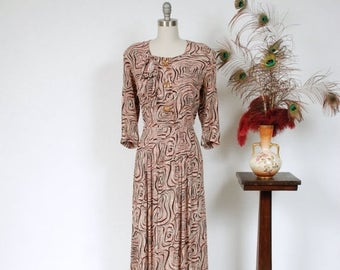 SALE - Vintage 1940s Dress - Fantastic Abstract Swirl Print Pink and Brown Rayon 40s Day Dress with Padded Shoulders and Large Bow