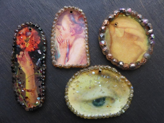 Handmade resin charm pendants with beaded frames by fancifuldevices