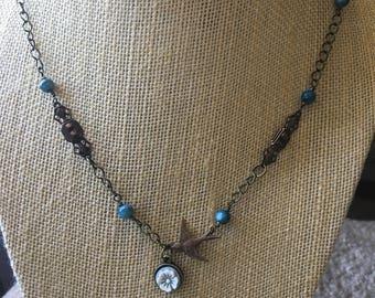 Brass bird beaded necklace