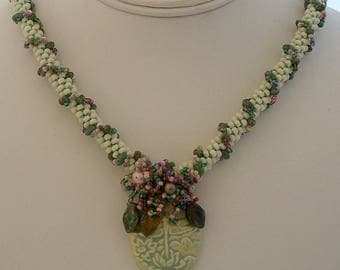 Green Ceramic Oval Dragonfly Pendant with a Pink White & Green Beaded Kumihimo Rope with Fringe Embellishment by Carol Wilson of Jet'adorn